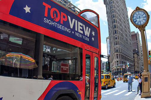 a TopView Double Decker Hop-on Hop-off Bus with Flatiron Building