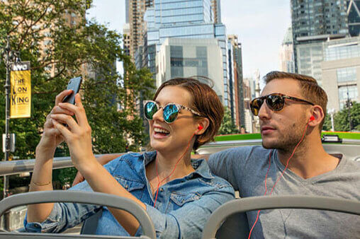 a Young Couple Taking Selfies at the Double Decker Bus