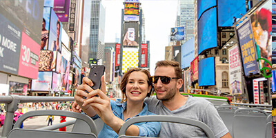 a Young Couple Taking Selfies in Time Square