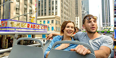 a Young Couple Sitting on a Double Decker Bus
