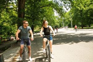 a Young Couple Cycling in Central Park