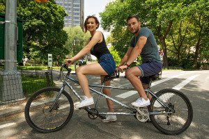 a Young Couple Taking a Tendem Bike